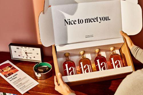 Коробка из четырех бутылочек алкоголя Haus